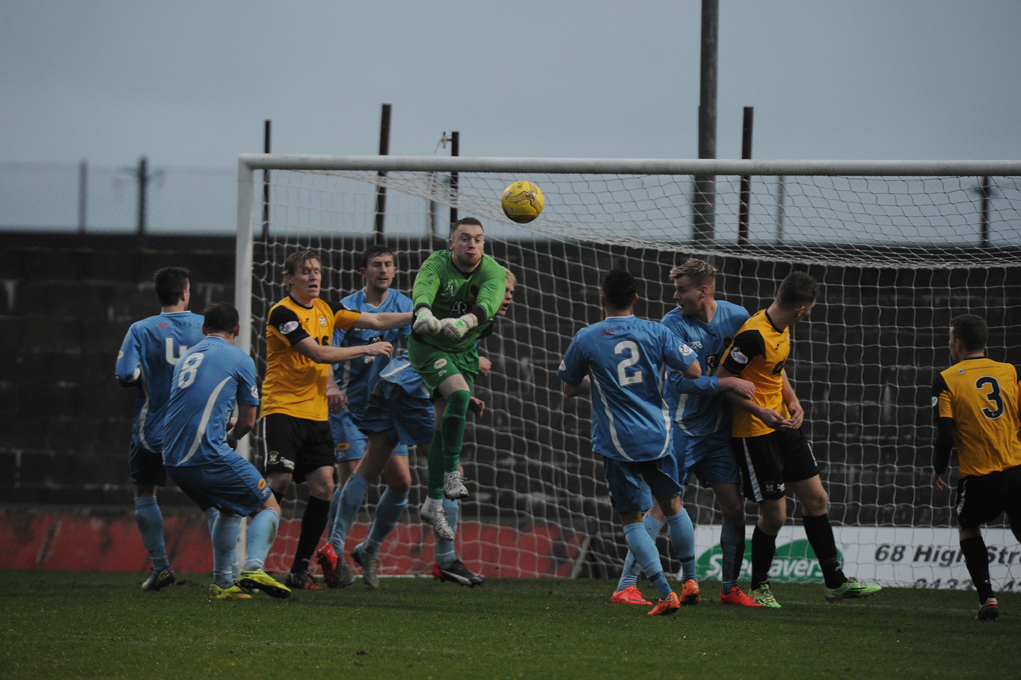 Berwick goalie Kevin Walker punches away the ball