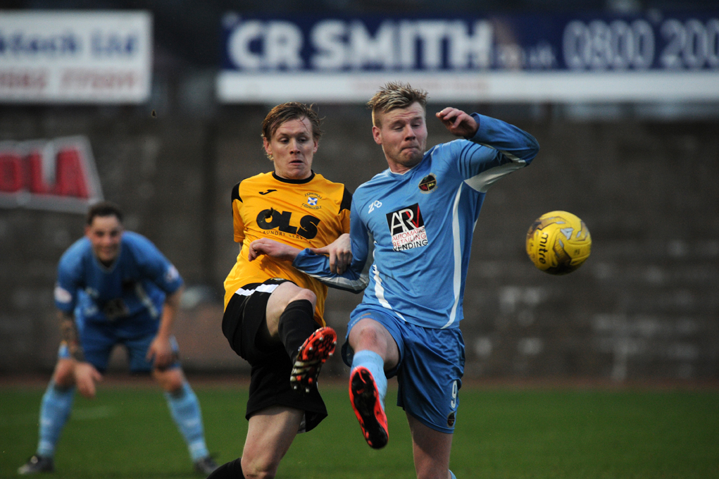 Blair Henderson appears to be held back by an East Fife man