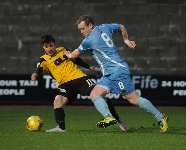 Former East Fife player Allan Walker attempts to get away from former Berwick Ranger Kyle Wilkie