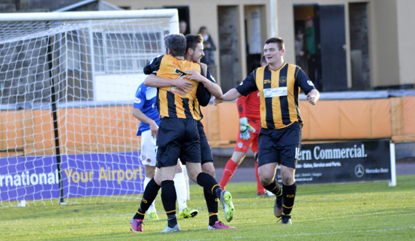 Rutherford is congratulated on scoring ( Photo courtesy of Ian Runciman )